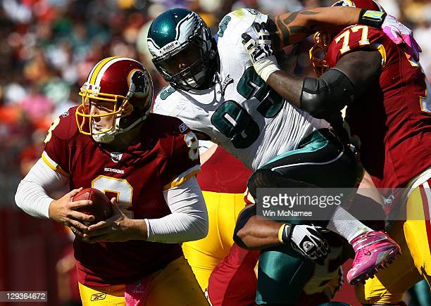 Quarterback Rex Grossman of the Washington Redskins is pressured by defensive end Jason Babin of the Philadelphia Eagles during first half action at...