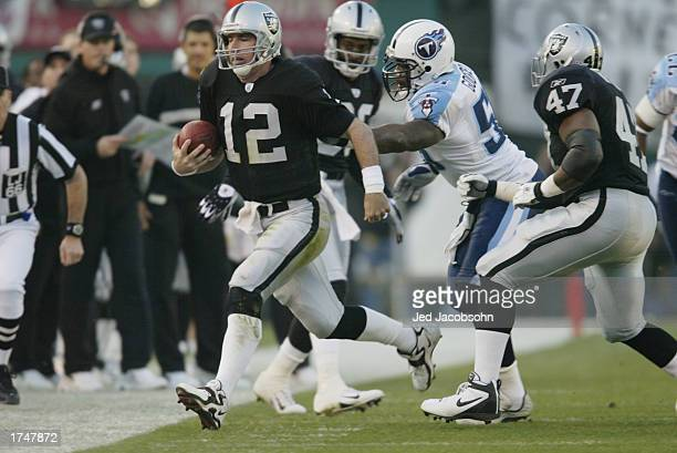 Quarterback Rich Gannon of the Oakland Raiders runs the ball out of bounds during the AFC Championship game against the Tennessee Titans at Network...