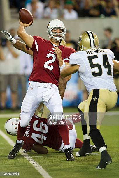 Quarterback Richard Bartel of the Arizona Cardinals throws over linebacker Will Herring of the New Orleans Saints during the second quarter of the...