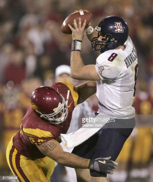 Quarterback Richard Kovalcheck of the Arizona Wildcats is hurried on an unsuccessful two point conversion attempt by defensive lineman Shaun Cody of...