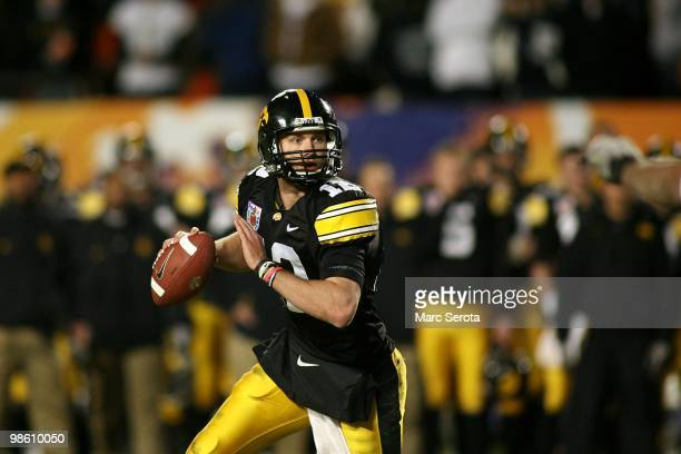 Quarterback Richy Stanzi of the Iowa Hawkeyes rolls out of the pocket against the Georgia Tech Yellow Jackets during the FedEx Orange Bowl at Land...
