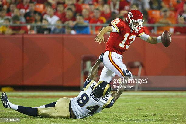Quarterback Ricky Stanxi of the Kansas City Chiefs is sacked by defensive end Robert Quinn of the St Louis Rams in a game at Arrowhead Stadium on...