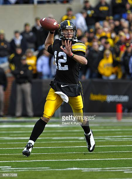 Quarterback Ricky Stanzi of the Iowa Hawkeyes looks for a receiver down field against the Indiana Hoosiers at Kinnick Stadium on October 31 2009 in...