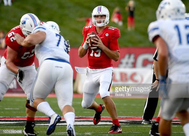 Quarterback Riley Neal #15 of the Ball State Cardinals drops back to pass during the first quarter of the game against the Central Connecticut State...