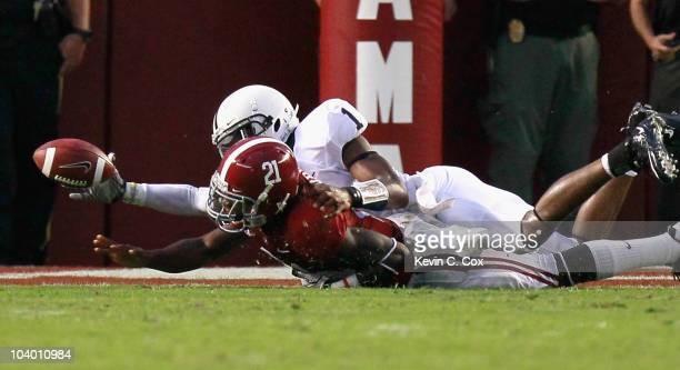 Quarterback Robert Bolden of the Penn State Nittany Lions forces a fumble by Dre Kirkpatrick of the Alabama Crimson Tide at BryantDenny Stadium on...
