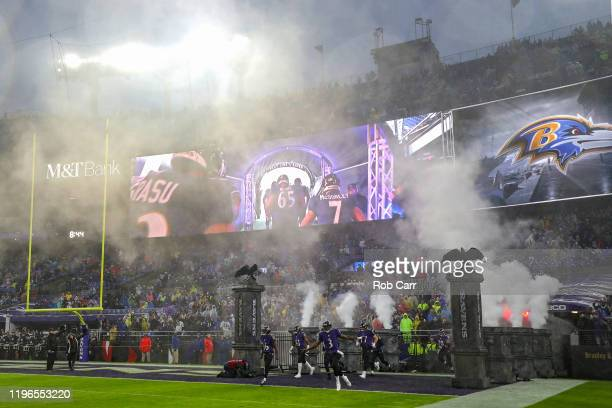 Quarterback Robert Griffin III of the Baltimore Ravens and teammates take the field before playing against the Pittsburgh Steelers at MT Bank Stadium...