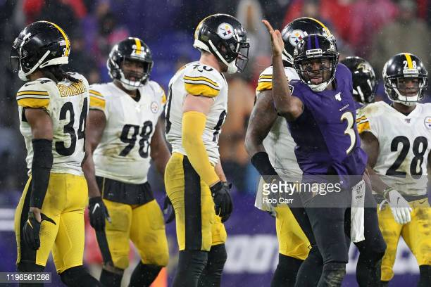 Quarterback Robert Griffin III of the Baltimore Ravens celebrates a first down against the Pittsburgh Steelers during the third quarter at MT Bank...