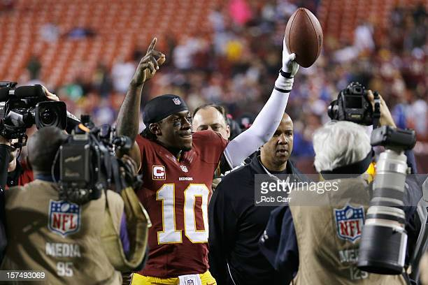 Quarterback Robert Griffin III of the Washington Redskins celebrates after the Redskins defeated the New York Giants 1716 at FedExField on December 3...
