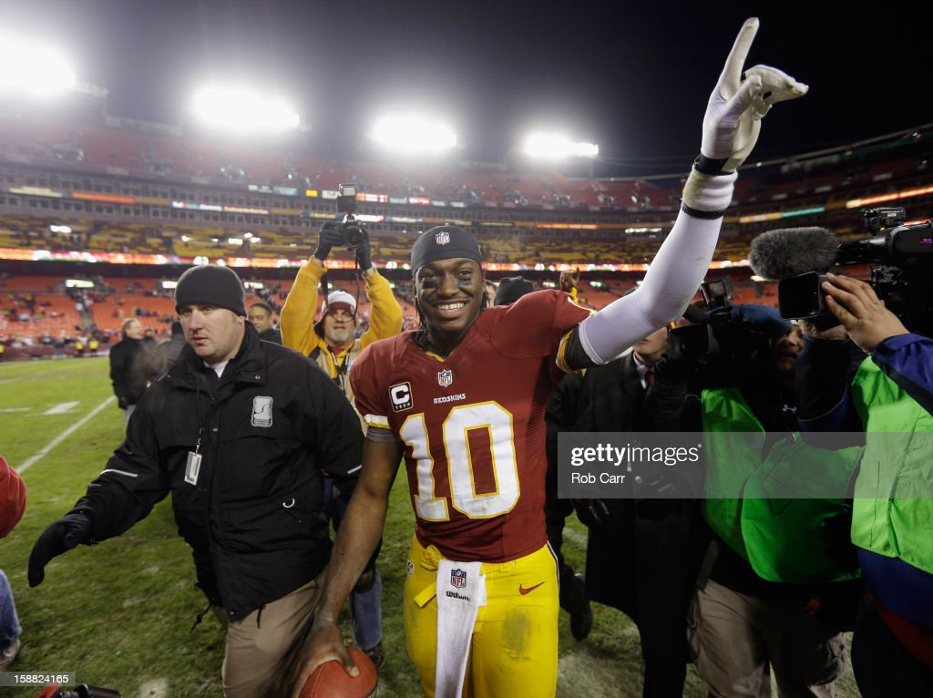 Quarterback Robert Griffin III #10 of the Washington Redskins celebrates after the Redskins defeated the Dallas Cowboys 28-18 at FedExField on December 30, 2012 in Landover, Maryland.