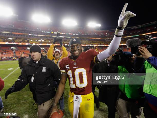 Quarterback Robert Griffin III of the Washington Redskins celebrates after the Redskins defeated the Dallas Cowboys 2818 at FedExField on December 30...