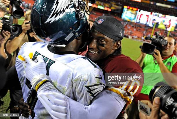 Quarterback Robert Griffin III of the Washington Redskins hugs quarterback Michael Vick of the Philadelphia Eagles after an NFL game at FedExField on...