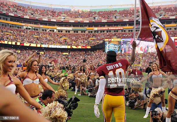 Quarterback Robert Griffin III of the Washington Redskins leads the team out onto the field before taking on the Philadelphia Eagles at FedExField on...