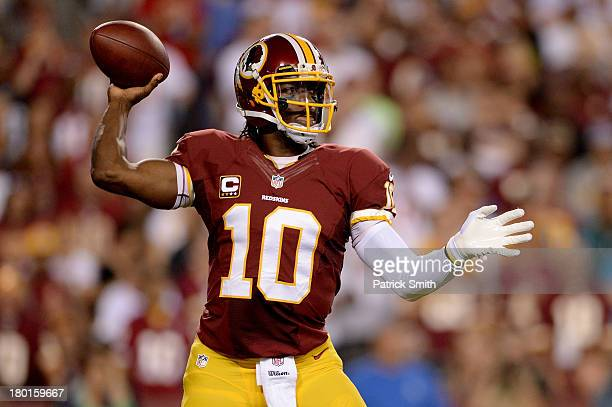 Quarterback Robert Griffin III of the Washington Redskins looks to pass in the first quarter against the Philadelphia Eagles at FedExField on...