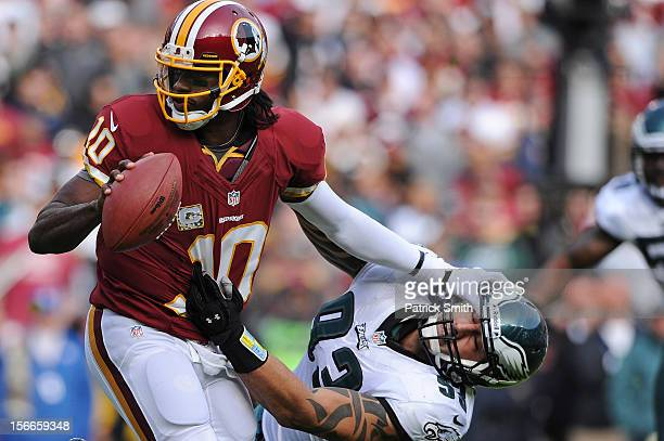 Quarterback Robert Griffin III of the Washington Redskins stiff arms defensive end Jason Babin of the Philadelphia Eagles in the second quarter at...