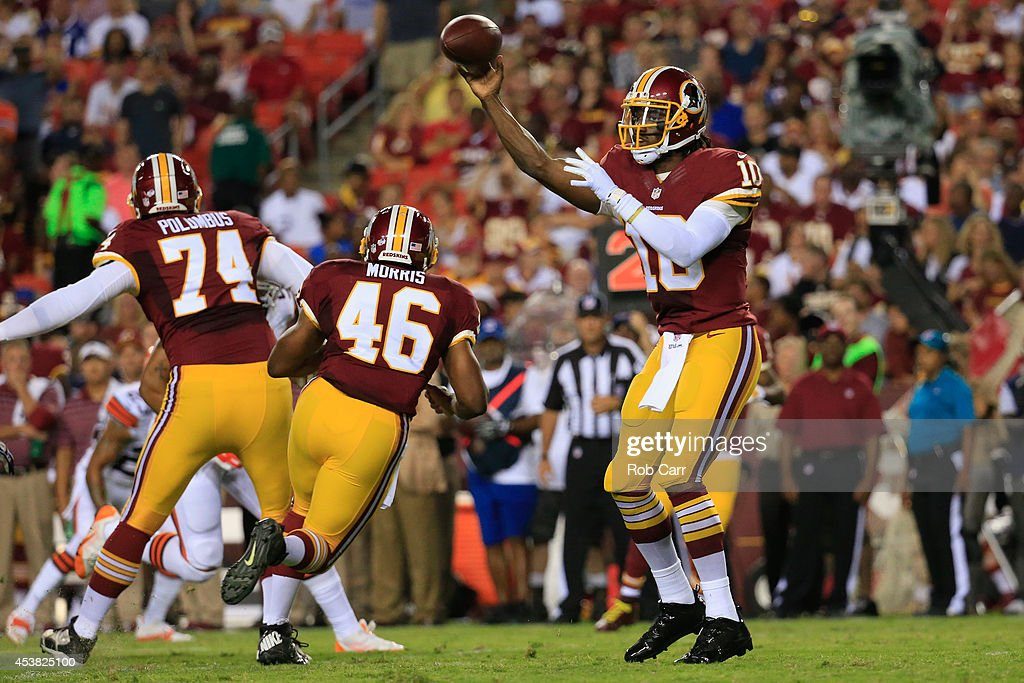 Quarterback Robert Griffin III #10 of the Washington Redskins throws a pass against the Cleveland Browns during a preseason game at FedExField on August 18, 2014 in Landover, Maryland.