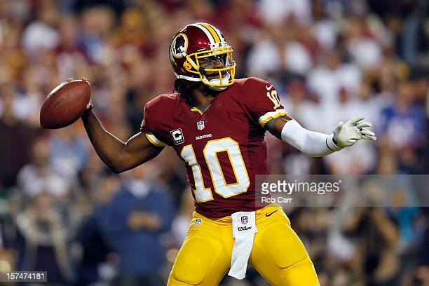 Quarterback Robert Griffin III of the Washington Redskins throws the ball in the first quarter while taking on the New York Giants at FedExField on...