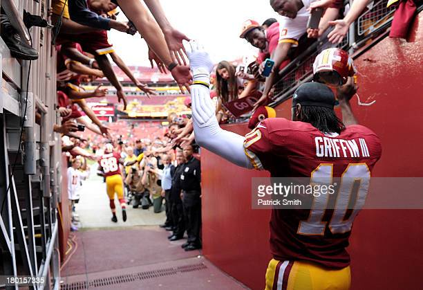 Quarterback Robert Griffin III of the Washington Redskins walks through the tunnel towards the field before taking on the Philadelphia Eagles at...