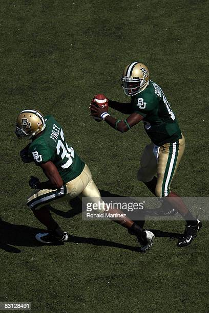 Quarterback Robert Griffin of the Baylor Bears drops back to pass against the Oklahoma Sooners at Floyd Casey Stadium on October 4, 2008 in Waco,...