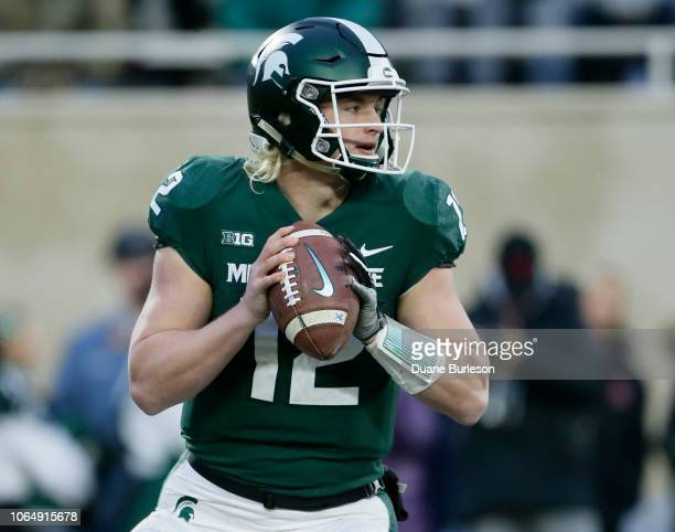 Quarterback Rocky Lombardi of the Michigan State Spartans looks to pass against the Rutgers Scarlet Knights during the first half at Spartan Stadium...