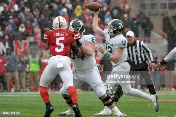 Quarterback Rocky Lombardi of the Michigan State Spartans passes against the Nebraska Cornhuskers in the second half at Memorial Stadium on November...