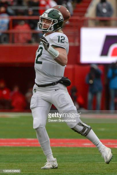 Quarterback Rocky Lombardi of the Michigan State Spartans passes against the Nebraska Cornhuskers at Memorial Stadium on November 17 2018 in Lincoln...