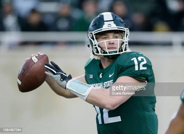 Quarterback Rocky Lombardi of the Michigan State Spartans passes against the Rutgers Scarlet Knights during the first half at Spartan Stadium on...