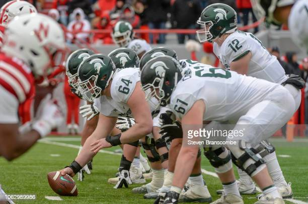 Quarterback Rocky Lombardi of the Michigan State Spartans prepares to take a snap from offensive lineman Matt Allen in the second half against the...