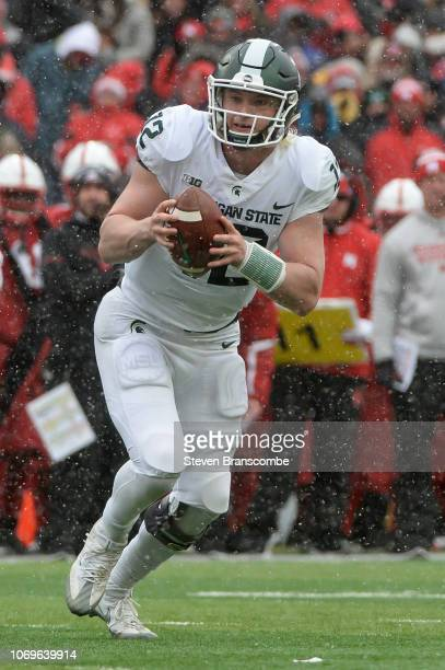 Quarterback Rocky Lombardi of the Michigan State Spartans runs against the Nebraska Cornhuskers at Memorial Stadium on November 17 2018 in Lincoln...