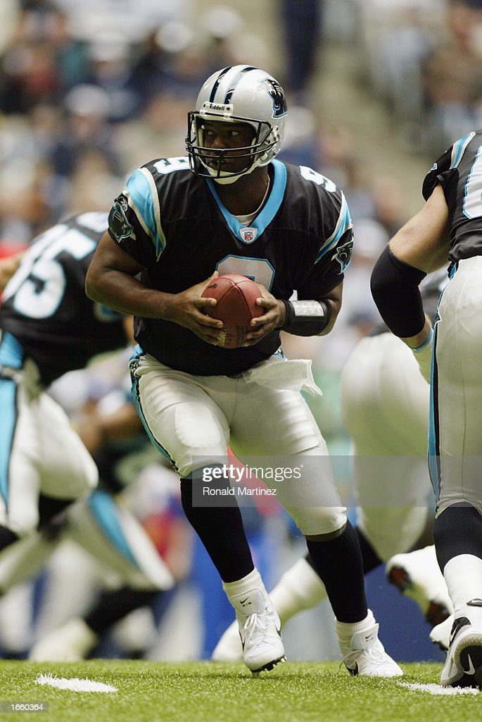 Quarterback Rodney Peete #9 of the Carolina Panthers drops back with the ball during the NFL game against the Dallas Cowboys at Texas Stadium on October 13, 2002 in Irving, Texas. The Cowboys defeated the Panthers 14-13.