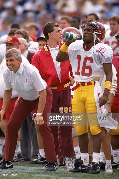 Quarterback Rodney Peete of the USC Trojans stands next to head coach Larry Smith on the sideline against the UCLA Bruins at the Rose Bowl on...