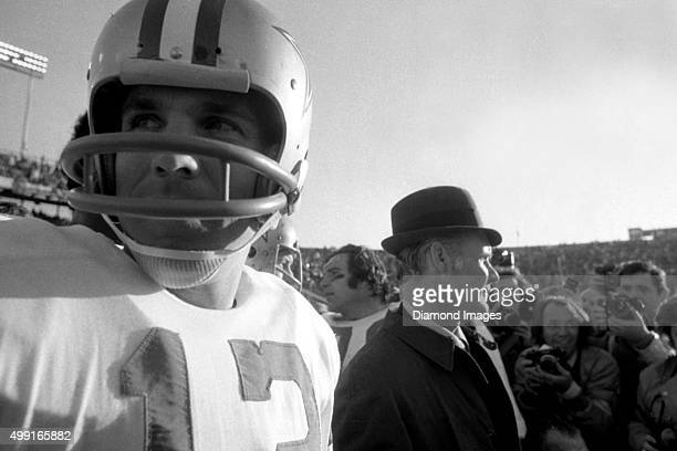 Quarterback Roger Staubach and head coach Tom Landry of the Dallas Cowboys stand on the sideline in a crowd of photographers after winning Super Bowl...