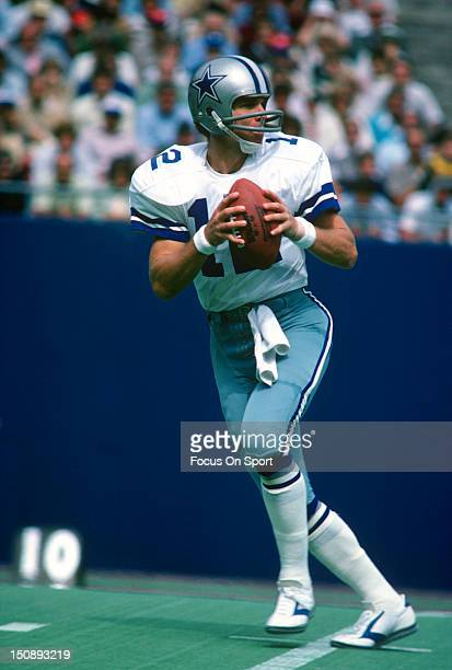 Quarterback Roger Staubach of Dallas Cowboys drops back to pass against the New York Giants during an NFL football game at Giants Stadium September...