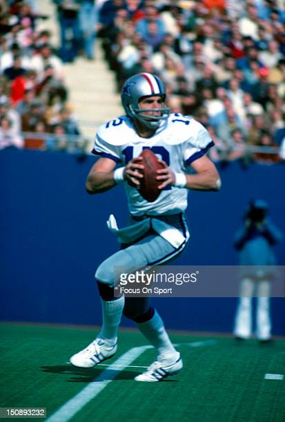 Quarterback Roger Staubach of Dallas Cowboys drops back to pass against the New York Giants during an NFL football game at Giants Stadium October 10...