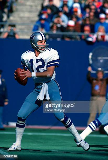 Quarterback Roger Staubach of Dallas Cowboys drops back to pass against the New York Giants during an NFL football game at Giants Stadium November 4...