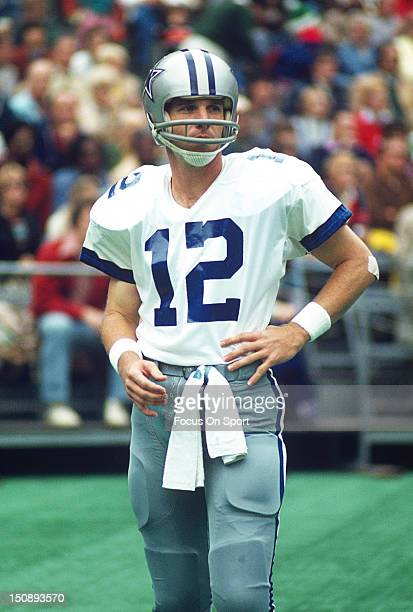Quarterback Roger Staubach of Dallas Cowboys looks on against the Philadelphia Eagles during an NFL football game at Veterans Stadium circa 1975 in...