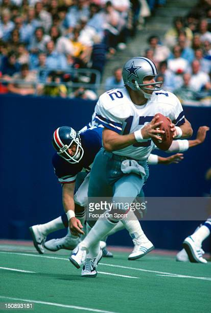 659a833993d Quarterback Roger Staubach of Dallas Cowboys rolls out to pass against the  New York Giants during