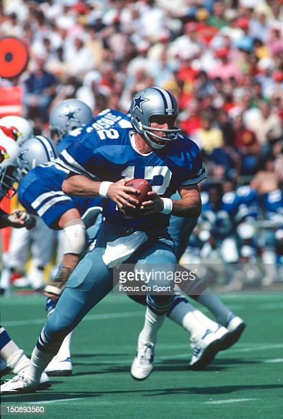 Quarterback Roger Staubach of Dallas Cowboys turns to hand the ball off against the St Louis Cardinals during an NFL football game at Busch Stadium...