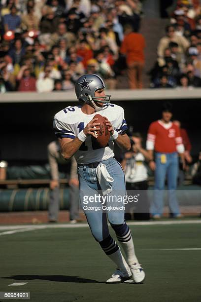 Quarterback Roger Staubach of the Dallas Cowboys drops back to pass against the Pittsburgh Steelers at Three Rivers Stadium on October 28, 1979 in...