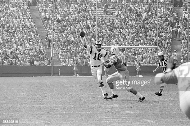 Quarterback Roman Gabriel of the Los Angeles Rams attempts to throw a pass over defensive end Joe Owens of the San Diego Chargers during a game circa...