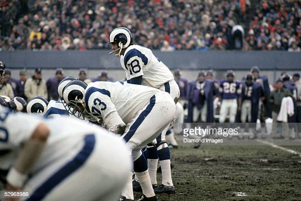 Quarterback Roman Gabriel of the Los Angeles Rams calls out the signals at the line of scrimmage during the Conference Chanpionship Game on December...