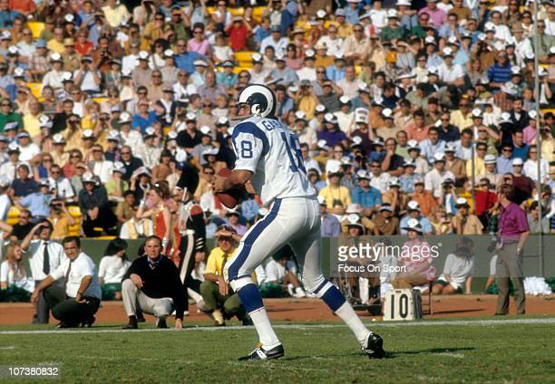 Quarterback Roman Gabriel of the Los Angeles Rams drops back to pass against the Green Bay Packers during an NFL football game at Lambeau Field...