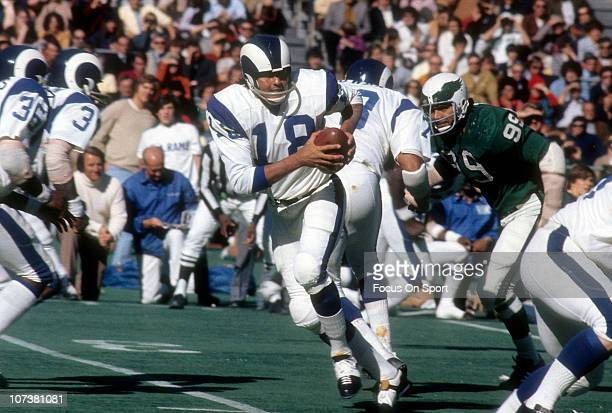 Quarterback Roman Gabriel of the Los Angeles Rams drops back to pass against the Philadelphia Eagles during an NFL football game at Veterans Stadium...