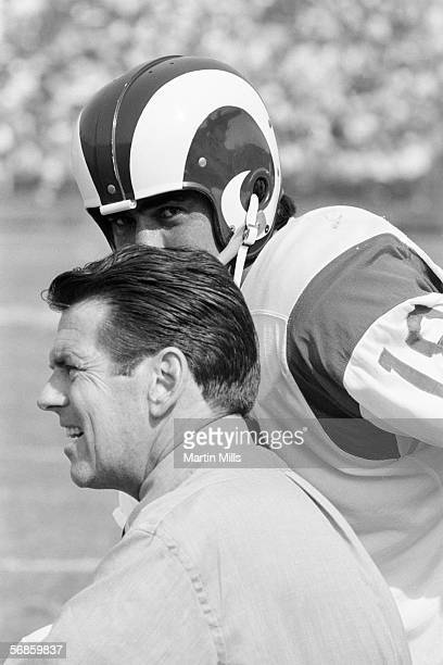 Quarterback Roman Gabriel of the Los Angeles Rams eyes over the head of Rams coach George Allen during a game circa 1960's. George Allen coached the...