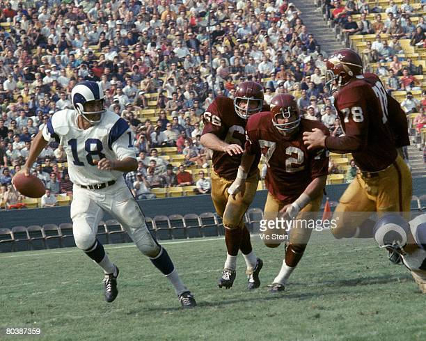 Quarterback Roman Gabriel of the Los Angeles Rams scrambles from pressure during an NFL game against the Washington Redskins at the Los Angeles...