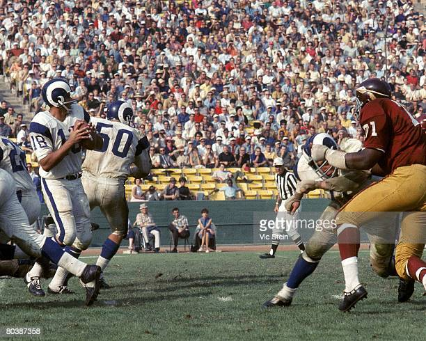 Quarterback Roman Gabriel of the Los Angeles Rams sets up to pass during an NFL game against the Washington Redskins at the Los Angeles Memorial...