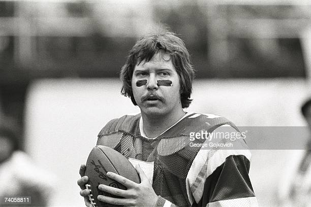 Quarterback Ron Jaworski of the Philadelphia Eagles warms up on the sideline during a playoff game against the Chicago Bears at Veterans Stadium on...