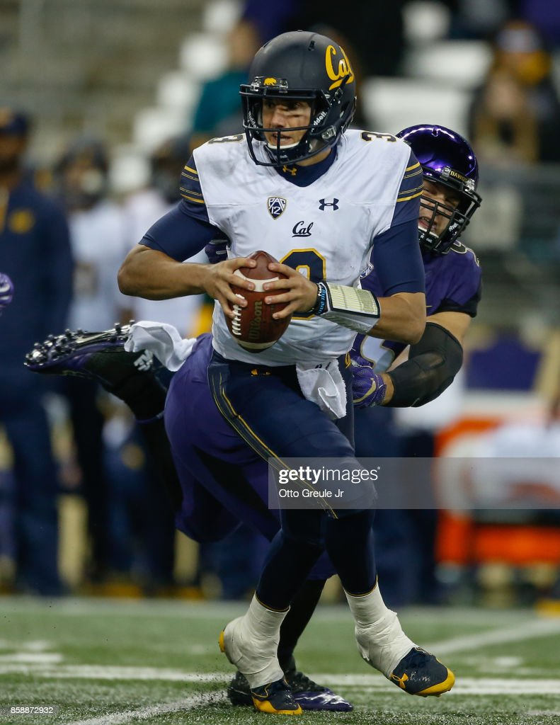 Quarterback Ross Bowers #3 of the California Golden Bears rushes under pressure from linebacker Ryan Bowman #55 of the Washington Huskies at Husky Stadium on October 7, 2017 in Seattle, Washington.