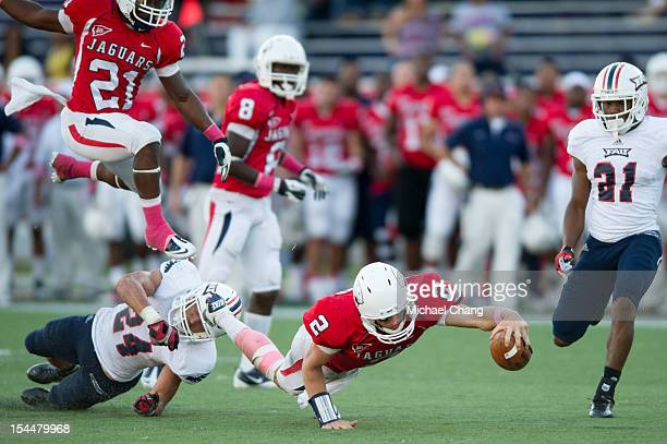 Quarterback Ross Metheny of the South Alabama Jaguars reaches for a first down while playing against the Florida Atlantic Owls on October 20 2012 at...