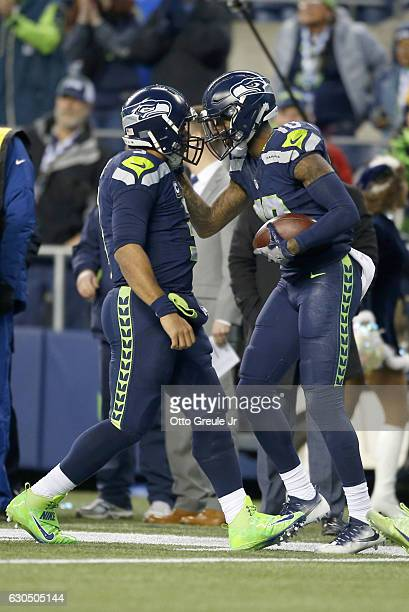 Quarterback Russell Wilson celebrates with wide receiver Paul Richardson after they connected on a touchdown against the Arizona Cardinals at...