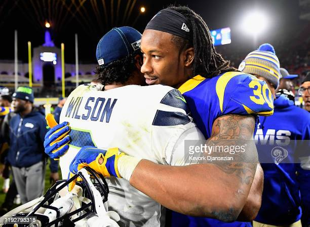 Quarterback Russell Wilson of the Seattle Seahawks and running back Todd Gurley of the Los Angeles Rams embrace after the Seahawks 2812 win the game...
